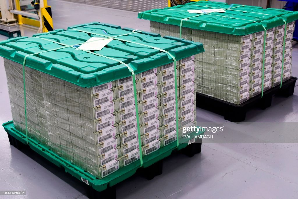 Freshly printed, bundled and packaged money sits ready for shippment