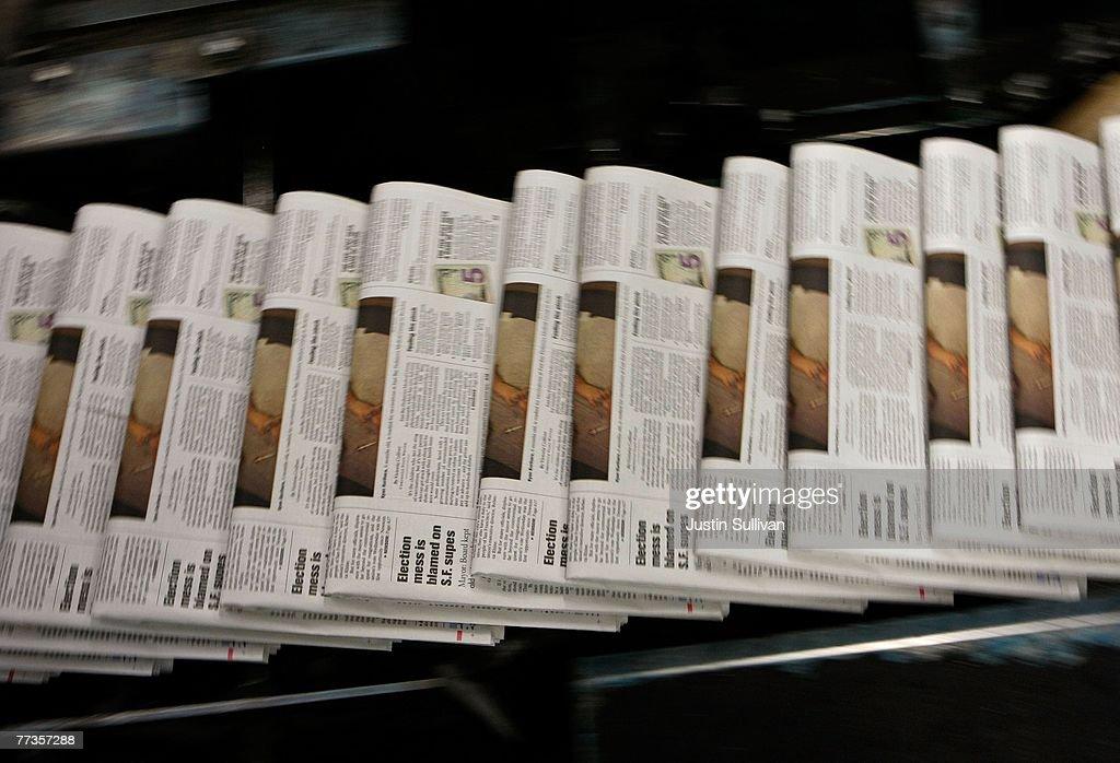 Dwindling Newspaper Sales Echo Through Economy : News Photo