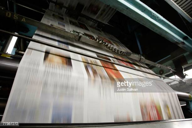 Freshly printed copies of the San Francisco Chronicle run through the printing press at one of the Chronicle's printing facilities September 20 2007...