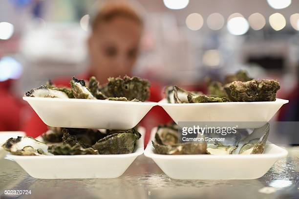 Freshly shucked oysters are displayed as crowds gather for last minute shopping before Christmas at the Sydney Fish Market on December 24 2015 in...