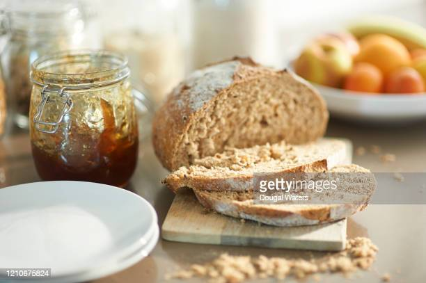 freshly sliced bread and jam in zero waste kitchen. - man made object stock pictures, royalty-free photos & images