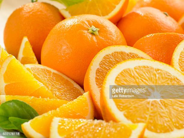 freshly sliced oranges - vitamin c stock pictures, royalty-free photos & images