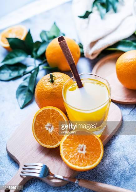 freshly squeezed orange juice - 冷たい飲み物 ストックフォトと画像