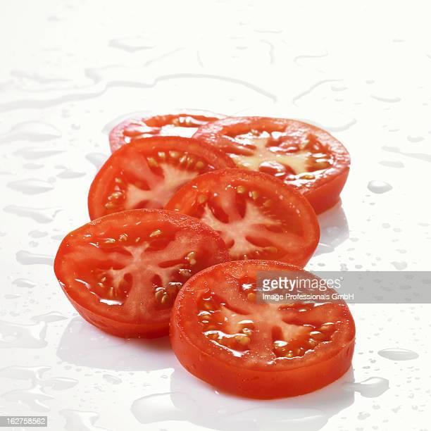 Freshly washed tomato slices