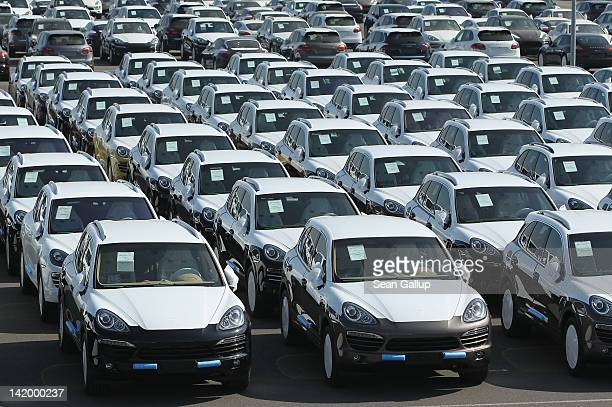Freshlyassembled Porsche Cayenne cars stand on a parking lot before shipping at the Porsche factory on March 28 2012 in Leipzig Germany The Cayenne...