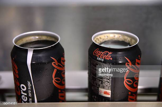 Freshlyfilled cans of Coke Zero move through the filling section before having caps attached at CocaCola Amatil Ltd's production facility in the...