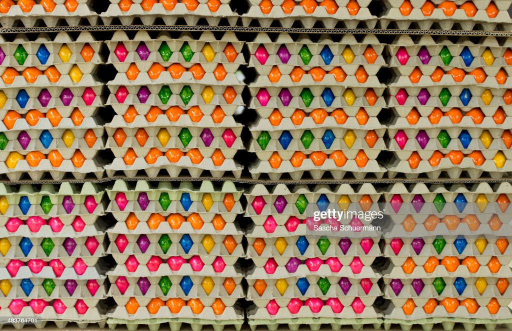 Freshly-painted Easter eggs are stacked in cartons at Baumeister Frischei egg and chicken farm on April 10, 2014 in Breckerfeld, Germany. The farm is among the biggest egg producers in the region, producing 120,000 chicken eggs daily to meet demand for its brightly-coloured eggs two weeks before Easter.