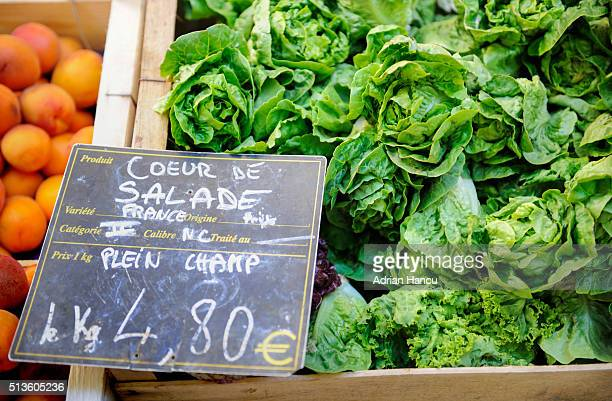 Freshly-picked lettuces on sale at  farmer's market in the iconic Place Richelme
