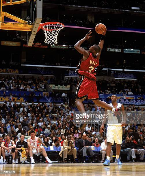 Freshman Dwyane Wade of the Miami Heat goes for a dunk against the Sophomore team during the Got Milk? Rookie Challenge, a part of the 2004 NBA...