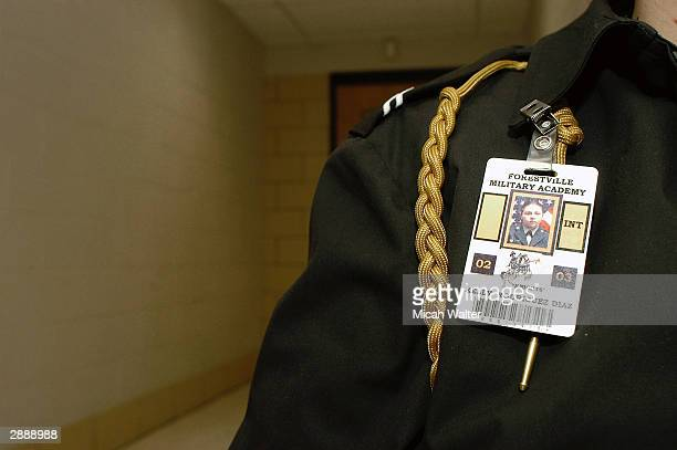 Freshman Kelly Rodriguez Diaz shows off her ID card and military insignia at the Forestville Military Academy January 21 2004 in Forestville Maryland...
