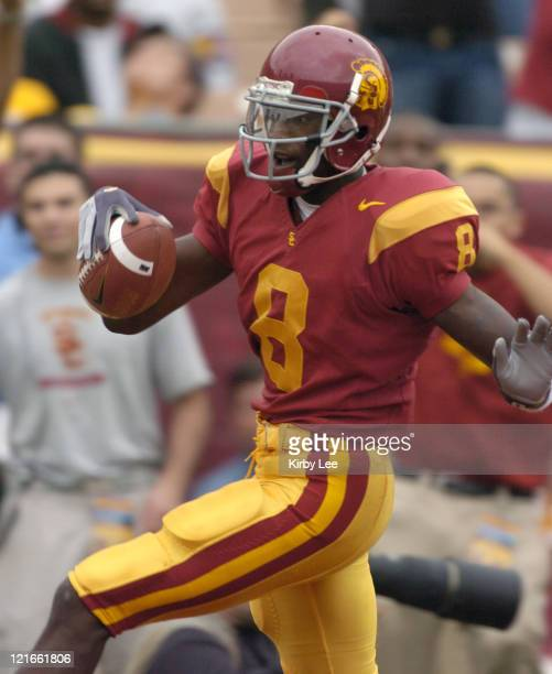 USC freshman receiver Dwayne Jarrett scores on a 52yard pass from tailback Reggie Bush during the second quarter of 457 victory over Arizona State in...