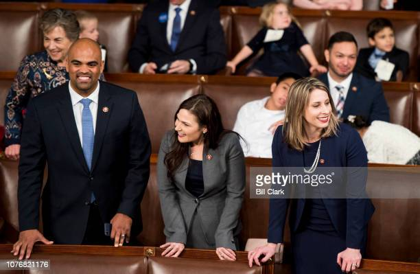 Freshman Reps from left Colin Allred DTexas Abby Finkenauer DIowa and Katie Hill DCalif talk on the House floor before the start of the election of...