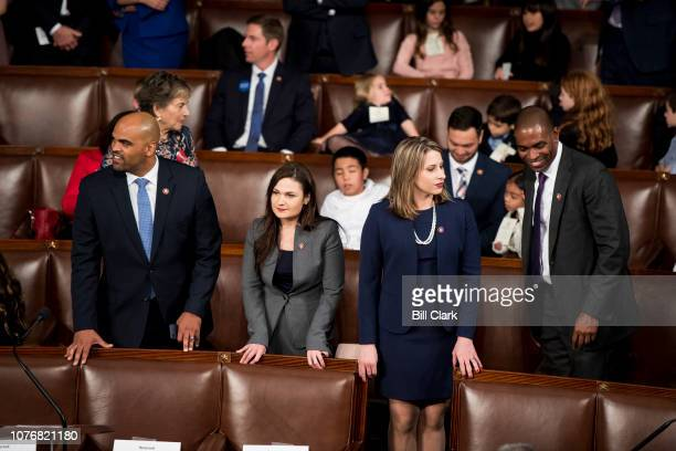 Freshman Reps from left Colin Allred DTexas Abby Finkenauer DIowa Katie Hill DCalif and Antonio Delgado DNY talk on the House floor before the start...