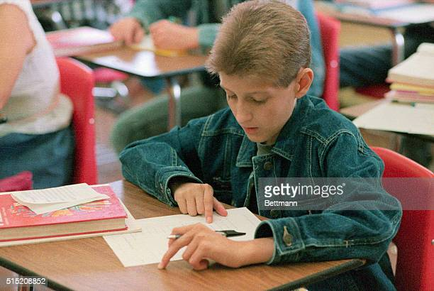 Freshman Ryan White works on a math assignment at Hamilton Heights High School in Arcadia Indiana on his first day of the new school year White a...