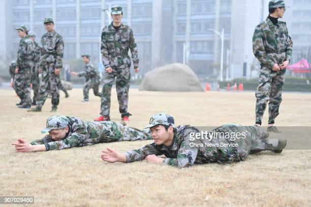 Freshman students of Hangzhou Normal University crawl during their twoweek winter military training on January 19 2018 in Hangzhou Zhejiang Province...