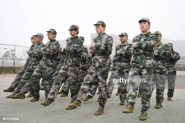 Freshman students of Hangzhou Normal University march during their twoweek winter military training on January 19 2018 in Hangzhou Zhejiang Province...