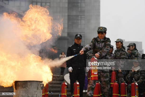 Freshman students of Hangzhou Normal University put out fire with fire extinguisher during their twoweek winter military training on January 19 2018...