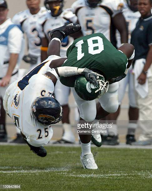 Freshman tight end Dwayne Holmes nearly gets his helmet ripped off by Kent State linebacker Cedric Davis Jehuu Caulcrick rushed for 140 yards and...