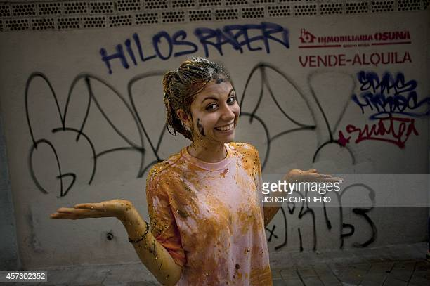 A freshman year medical student covered with food stuffs poses during a faculty of medicine hazing at the University of Granada in Granada on October...