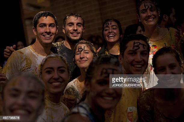 Freshman year medical students covered with food stuffs pose during the faculty of medicine hazing at the University of Granada in Granada on October...