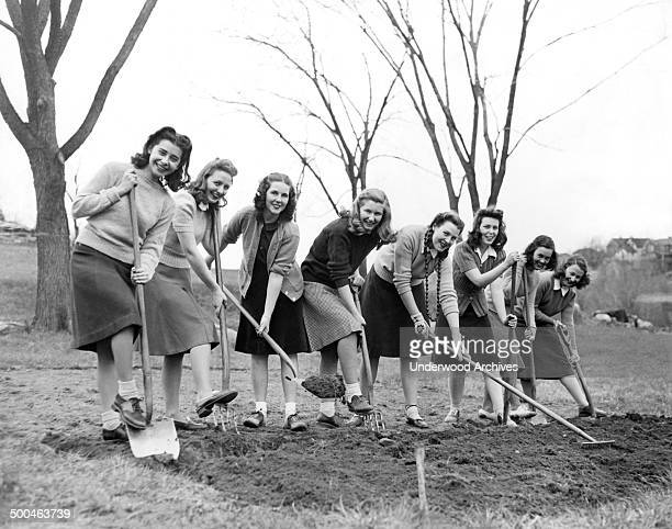 Freshmen girls at Good Counsel College break ground for a WWII victory vegetable garden on their 40 acre campus White Plains New York April 23 1942