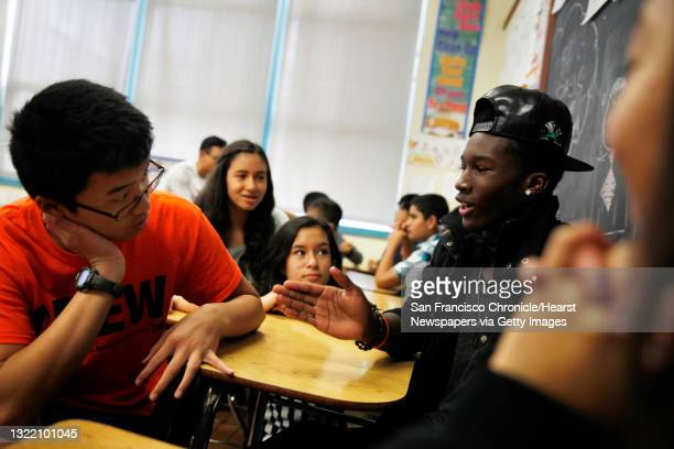 Freshmen Kevin Wu and Tyree Rochelle discuss their classroom exercise in their group with Anna Volshka , Alexandra Rosenthal and Wendy Li as they...