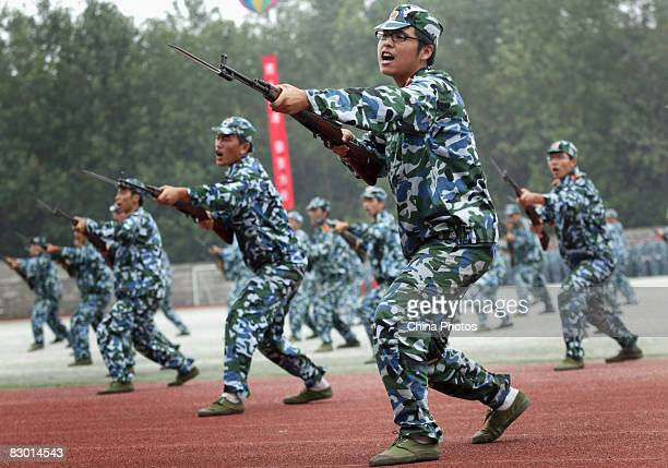 Freshmen practise fighting skills during a military training at a university on September 25 2008 in Gaochun County of Jiangsu Province China China's...