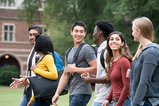 Freshmen University Students Walking on Campus with New Friends - gettyimageskorea