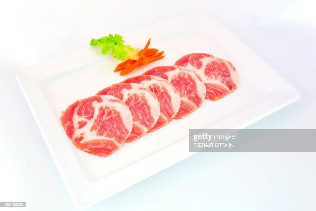 freshness slided pork on white dish for grill ストックフォト getty