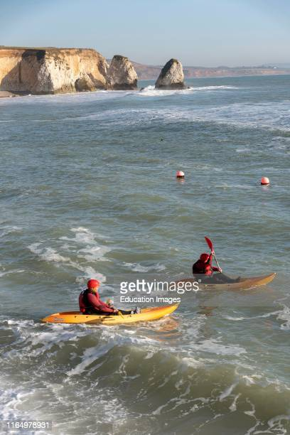 Freshwater Bay, Isle of Wight, England, UK, Couple learning to kayak in a slight swell on Freshwater Bay in the west of the Isle of Wight a popular...