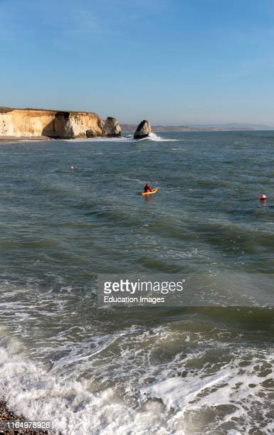 Freshwater Bay, Isle of Wight, England, UK, Incoming tide and a kayaker.
