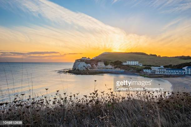 freshwater bay sunset - freshwater bay isle of wight stock pictures, royalty-free photos & images