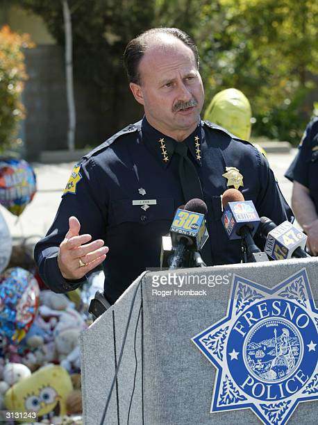Fresno City Police Chief Jerry Dyer speaks to the media about removing the memorial in front of Marcus Wesson's house on March 25 2004 in Fresno...