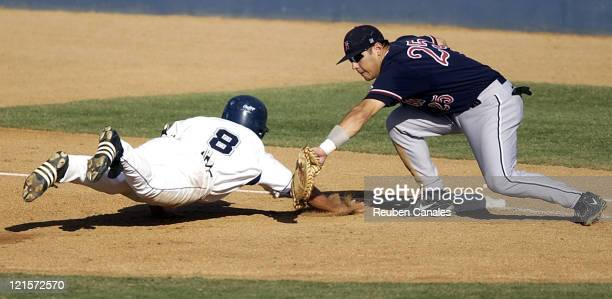 Fresno State Bulldogs first baseman Kent Sakamato tags Toreros baserunner Ryan Lilly out as they deafeated the University of San Diego Toreros 9 to 8...