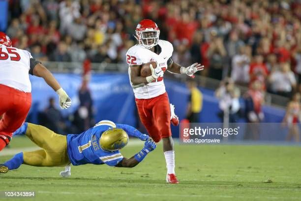 Fresno State Bulldogs running back Jordan Mims runs hard for a first down during a college football game between the Fresno State Bulldogs and the...