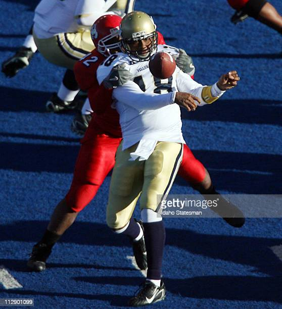 Fresno State defensive tackle Charles Tolbert pressures Georgia Tech quarterback Calvin Booker into an incomplete pass in the second half of the...