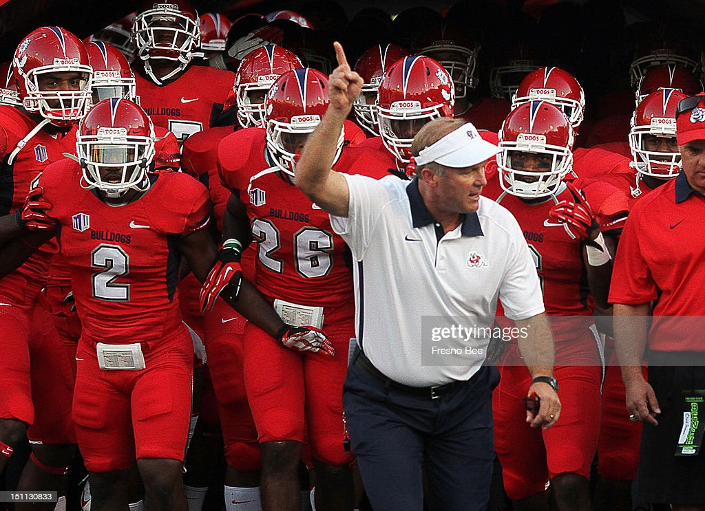 Fresno State head football coach Tim DeRuyter leads the team