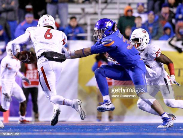 Fresno State quarterback Marcus McMaryion slips through the grasp of Boise State linebacker Leighton Vander Esch in the Mountain West championship at...