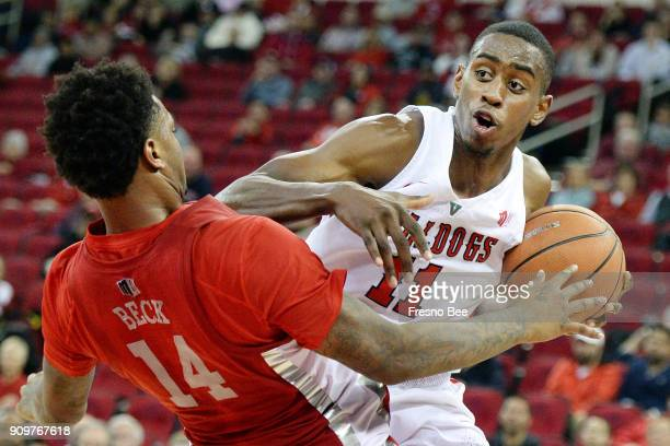 Fresno State's Bryson Williams right gets called for a charge on UNLV's Tervell Beck in the first half on Tuesday Jan 23 2018 at the Save Mart Center...