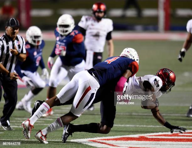 Fresno State's Mike Bell left tackles UNLV's Kendal Keys right in firsthalf action on Saturday Oct 28 at Bulldog Stadium in Fresno Calif
