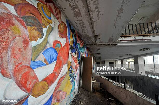 Fresos flake off the walls at the now derelict cultural centre in the abandonned city of Pripyat close to Chernobyl on March 31 2011 The project to...