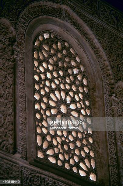 'A fretwork window with epigraphs by Nasrid craftsmen 12th14th Centuries fretwork stone Spain Granada Alhambra Whole artwork view Interior view of a...