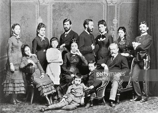 Freud Family. Photography. Around 1876. Standing , Paula, Anna, unknown girl, Sigmund, Emanuel , Rosa, Maria or 'Mitzi', Simon Nathanson ; seated:...