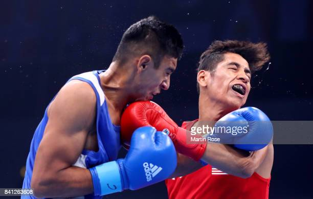 Freudis Rojasi of USA and Ikboljon Kholdarov of Uzbekistan fight in the Men's light welter during the semi finals of the AIBA World Boxing...