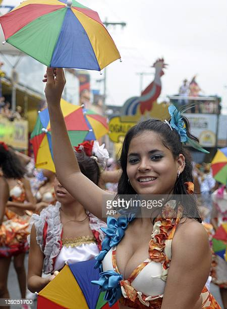 A frevo dancer performs with the Galo da Madrugada street carnival band on February 18 2012 in Recife northeastern Brazil The frevo is a style of...