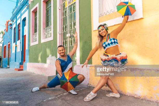 frevo dancers performing on street - frevo imagens e fotografias de stock