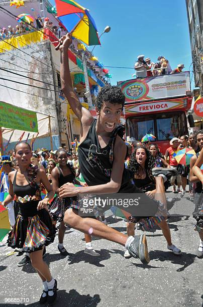'Frevo' local traditional musical style dancers perform along Recife's streets in northeastern Brazil on February 14 during carnival Frevo is danced...