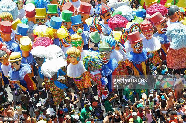'Frevo' local traditional musical style dancers perform with giant dolls along Recife's streets in northeastern Brazil on February 14 during carnival...