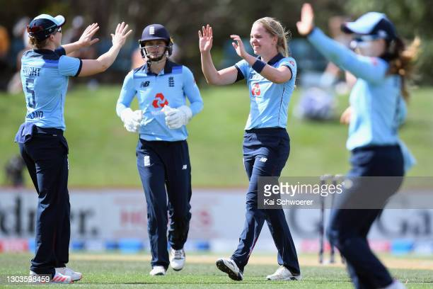 Freya Davies of England is congratulated by team mates after dismissing Amelia Kerr of New Zealand during game one of the One Day International...