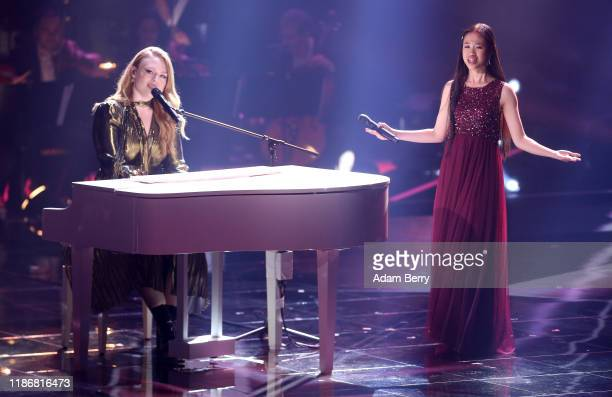 Freya Ridings and Claudia Emmanuela Santoso perform during the finals of The Voice of Germany on November 10 2019 in Berlin Germany